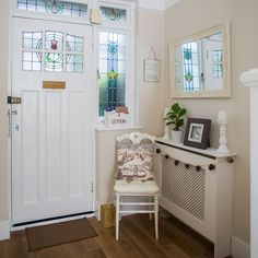 Take a look around this festive renovated home in Surrey Hallway - elegant country cream colour scheme and a radiator cover Hallway Colour Schemes, Hallway Colours, Upper East Side, 1930s Hallway, Modern Hallway, 1930s House Interior, Interior Design, Interior Ideas, Best Radiators