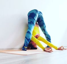 Straddle forward fold against the wall for posture. Yoga love
