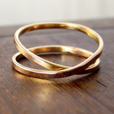 i simply adore this. rose gold infinity ring, yep.