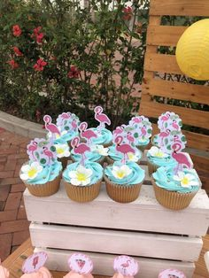 Don't miss the wonderful cupcakes at this flamingo birthday party! See more party ideas and share yours at CatchMyParty.com #catchmyparty #partyideas #flamingoparty #girlbirthdayparty #summerparty #tropicalparty #flamingocupcakes