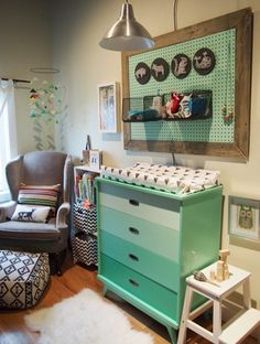 Colorful framed pegboard in a little boy's nursery - via Apartment Therapy.