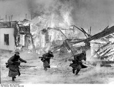 """German infantry attacking through a burning Norwegian village. Deutsches Bundesarchiv Wikipedia """"Battle of Norway""""."""