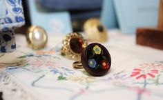 Vintage button rings at Round She Goes