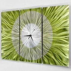 Unique wall clocks make excellent pieces of home wall art décor.  In fact, the right large wall clock can truly elevate any room of your home.  Indeed, this one is truly timeless and one of a kind.  Truly charming, sophisticated and one of the best decorative wall clocks to use when sprucing up your home.  I love the popular style and design of this wall decoration.   Abstract Modern Bright Green and Silver Metal Wall Clock - Hand-