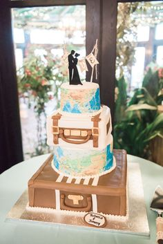 Travel themed wedding and wedding cake at the Gramercy | Marlayna Photography marlaynaphotography.com