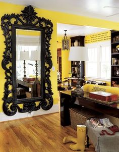 Focal point. Black mirror really pops on the golden yellow wall. i need this mirror!!!!!