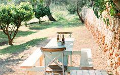 Dine in the garden at restaurant La Paloma.