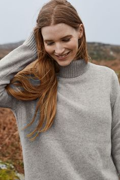 Our Lithograph Jumper is a midweight, longer line roll-neck knit in a cosy merino blend. Handsome deep rib detailing adds interest and texture on the neck, down the sides and on the hem and cuff.