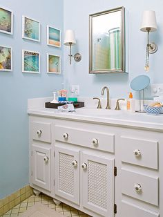 Consider adding feet in master suite for more of a classic furniture look. Paint. Consider molding and/or medallions for more piled on look. Also consider molding around existing expansive mirror and possibly break in center for countertop storage.