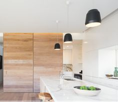Nice kitchen with timber feature all as Tathra Beach Designs