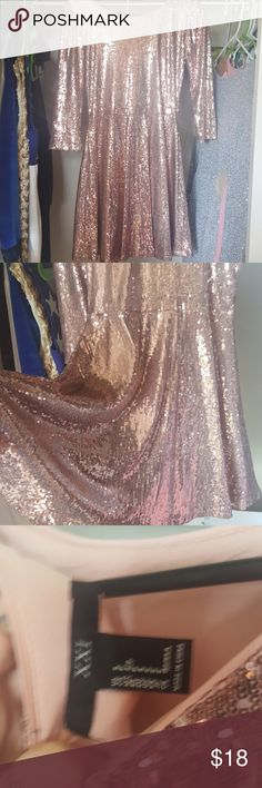 Rose gold colored long sleeve skater sequin dress Rose gold colored long sleeve skater sequin dress. Very very very beautiful. Very shiny and flowy around the skirt. It is a size small and it would be perfect for New Year's Eve or any holiday party. I can send next day and I do accept offers or trades, so bundle a lot and save on the sale. xxi Dresses