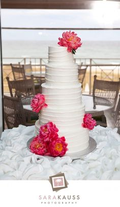 white wedding cake, with huge pink flowers #weddingcake