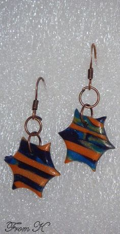 "Stripe polymer clay Spike dangle earrings. Created by using the mokume gane technique with many layers of transitioning palettes. Featured colors are light blue, yellow, eggplant purple and the main fire orange (all in shimmer). Because each piece is handmade, every piece is completely unique and carries its own ""flaws"" making it one-of-a-kind. Total length 3 cm 7.00 Ron"