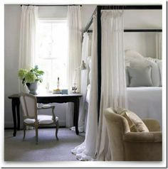 Curtains don't always have to be heavy- these gauzy sheer ones give an ethereal feeling to this bedroom.