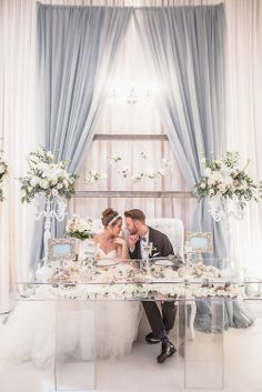 Love the clear table w/ flowers, & the dress :) ... oh and of course the bride and groom! (2014 wedding trendswedding photo-8516.jpg | Anne Edgar)