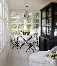 Serene Enclosed Veranda | Designer: Rollande Vachon | Photographer: Jean Longpré | #porch #veranda #sunroom #summerliving #interiordesign