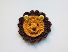 Crochet a lion (refrigerator magnet, bookmark- add icord and end with tassel tail).