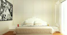 Progettazione camera da letto con pedana rialzata su cui è stata collocato l'armadio.