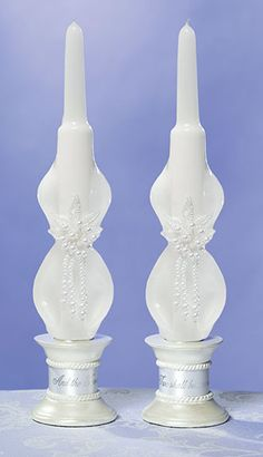 "Lillian Rose Pair of White Carved Pearled Taper Candles This pair of white carved taper candles is decorated with a pearl design. Each measures 10"" tall. Price $6.50"