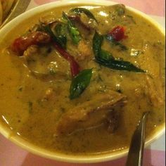 Alleppey chicken curry, at Paragon Calicut Restaurant, Calicut, Kerala. Dried red chillies, lots of curry leaves, a smooth coconut sauce, chicken on the bone.