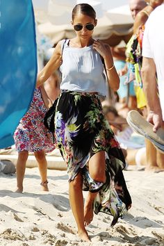 While on vacation wither her family in Saint Tropez on July 23rd, fashion icon Nicole Richie can be found in full on beachwear. Richie's last beach look includes an icy periwinkle tank, high-low floral skirt, Ray-Ban shades, and a single gold bangle. She makes a casual and fashionable beach trip look easy!
