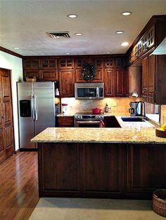 Hoosier at Heart: Dark cabinets and granite in small kitchen