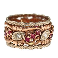 14K pink gold wide band circa 1940's with alternating 3 rubies & marquise shapes with round diamond and white gold edges in flower & marquise shapes.