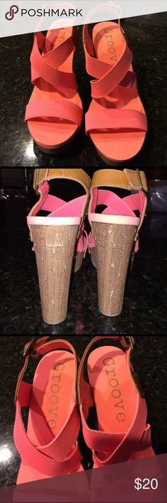 """Groove coral colored high heels NWOT-never worn just tried on ! Gorgeous soft cushiony hi-heels (platform) with a 1.5 platform and 5"""" faux look a like wooden heel! Cute little peace sign buttons holding the criss cross elastic straps with a brown adjustable buckle.  Such a cute old school statement shoe! So very comfortable!😊 Shoes Platforms"""