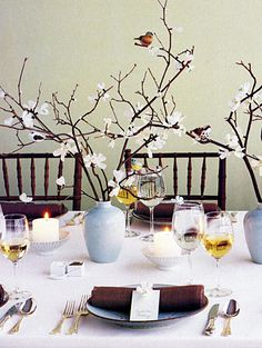pretty table setting idea. I think I am going to incorporate the twigs with roses in a teapot for Ayla's centerpieces. We have lots of dainty tables for the party