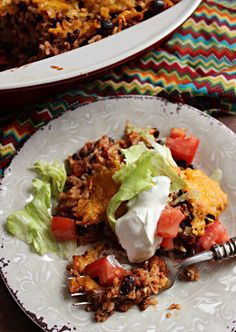 Taco Rice Casserole. This flavorful Taco Rice Casserole comes together quickly and is perfect for Taco Tuesday! Your family is sure to enjoy it! #tacocasserole  #ricecasserole #easydinnerideas #dinnerideas #dinnerrecipes #familymeals #easyrecipes #comfortfoodrecipes #ricedinners #tacotuesday #tacoideas