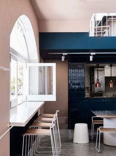 Melbourne café Moby takes colour blocking into a modern realm : Bright white windows frame the street view, bringing the outside in — an important hallmark of the Australian dining scene.