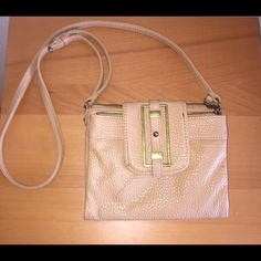Ninee West Crossbody Great Condition. 46 inch adjustable strap. Length 7.5 inches Width 8.5 inches. A little peeling at the back snap. No trades.  Nine West Bags Crossbody Bags