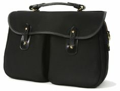 We have produced a new specification of the popular Monmouth briefcase.  Under the main flap there is a zipped main compartment and two pleated front pockets.  There are phone and pen pockets inside the main compartment and on the outside there is an  accessible back pocket with press stud closure.  Harness-leather handle and detachable webbing shoulder strap.