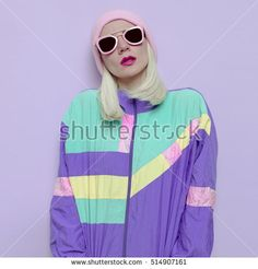 hipster blonde girl in fashionable hat trend and pink glasses Vanilla fall winter