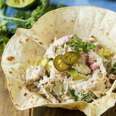 Creamy Jalapeno Chicken Salad has a little zip from pickled jalapenos and lime juice. Serve in a homemade tortilla bowl for a fun presentation.
