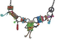 Un ras du cou,dans le coup!Une grenouille qui chante et joue de la guitare,c'est le collier ultra stylé qui permettra de vous démarquer. Le collier fantaisie dans la tendance peace and love