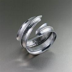 Aluminum Cuffs and Bangles by John S Brana / Aluminum Fold Formed Anticlastic Bangle