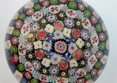 "Clichy, concentric circle millefiori paperweight in a pink and white stave basket, ca. 1850. Two rings in the design are composed of Clichy cabbage rose canes. 3 1/8"" (7.9 cm) diameter. $7,000.00"