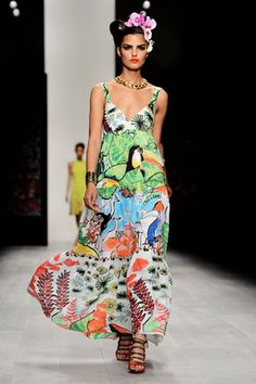 """ISSA The theme of the Issa show was """"goddess"""" and we can see why! This collection was full of slinky maxi's and jumpsuits in super-bright red and fuchsia tones"""