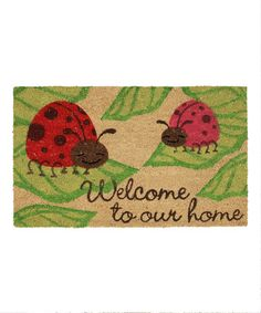 Extend a warm welcome to family and friends with this charming coir doormat, showcasing a cheerful ladybug motif and typographic detail.