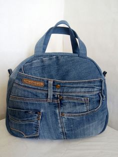 Best 11 Love the rounded shape of this upcycled denim handbag, the floral embroidery, and the leather straps! Jean Purses, Purses And Bags, Jean Diy, Denim Handbags, Denim Purse, Art Bag, Recycled Denim, Patchwork Bags, Cotton Bag