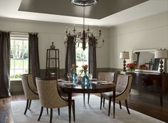 Benjamin Moore Paint Colors - Neutral Dining Room Ideas - Distinctive Dining Room - Paint Color Schemes . . . . . For a twist, a dark ceiling accent adds dimension to this dining room. . . . . Walls - Stone Hearth (984); Ceiling Accent & Wainscoting (center rectangle of ceiling) - North Creek Brown (1001); Ceiling (outer stripe around ceiling) - Dune White (968). . . . Note:  Ceiling is flat.  Tray-Ceiling-look is only an illusion with paint colors.