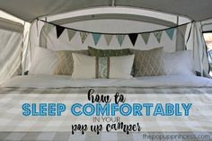 This little tricks will help you sleep just as comfortably on your pop up camper mattress as you do at home.  #popupcamper #popupcampermattress #glamping #camperbed #popup