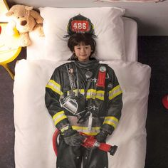 A lifesaving hero, which child doesn't dream of becoming one? This bedding makes that dream practically come true. Because the print of this firefighter suit looks so real, it's surreal.  Duvet cover set with photographic print. Made of 100% high quality soft cotton. Includes pillow case. Designed in Holland, made in Portugal.