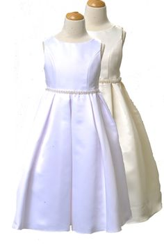 Simple, yet elegant sleeveless dress with beaded waist and a full skirt. High neckline, comes with a petticoat. Available in white and ivory. Made in the USA. Ideal for weddings, first  $59.99