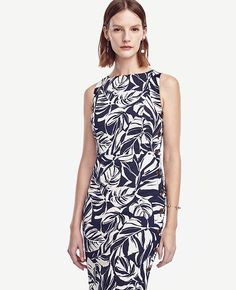 """Rendered in a leafy tropic-inspired print, this confident style is punctuated with side buttons for an endlessly polished finish. Boatneck. Sleeveless. Faux side button placket. Waist seam. Side vent. Hidden back zipper with hook-and-eye closure. Lined. 25"""" from natural waist."""