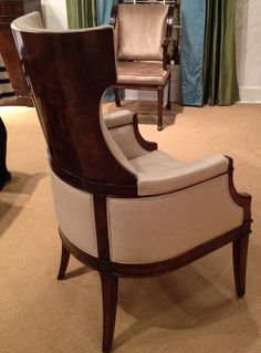 Elise Arm Chair by Council.  This is easily one of the most beautiful host dining chairs I've ever seen.  The wood that wraps the frame is so rich and makes an elegant statement with the contrasting lighter fabric.  Simply stunning!