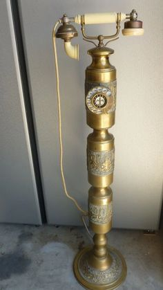 1930 Brass rotary phone with cord..