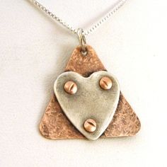 Riveted Adoption Symbol Necklace - Crow Steals Fire