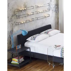 A set of candles on the walls which substitute a function of bed lamp, romantic! #rumahkubedroom